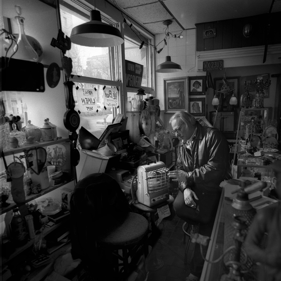Portrait of Bill Stettner in his shop 'The Garage Sale', New York © Peter Adams 1991