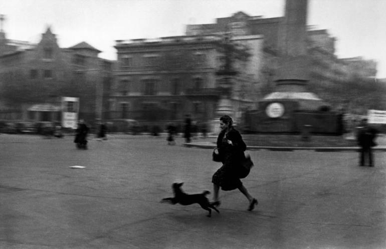 SPAIN. Spanish Civil War (1936-9). Barcelona. January, 1939. The Spanish Civil War broke out in 1936, when part of the Spanish army rebelled against the Second Republic, a democratic government elected in 1931. It gained international dimensions when Fascist Germany and Italy began supporting the military uprising, led by General Franco, with weapons and soldiers. The USSR helped the Republic, and a significant contingent of volunteers joined the International Brigades and fought for the Republic. The conflict became the symbol of a larger conflict between Fascists and Communists. The war ended in 1939 with Franco's victory over the Republicans. Running for shelter during the air raid alarm. The city was being heavily bombed by Fascist planes, as General Franco's troops rapidly approached the city.