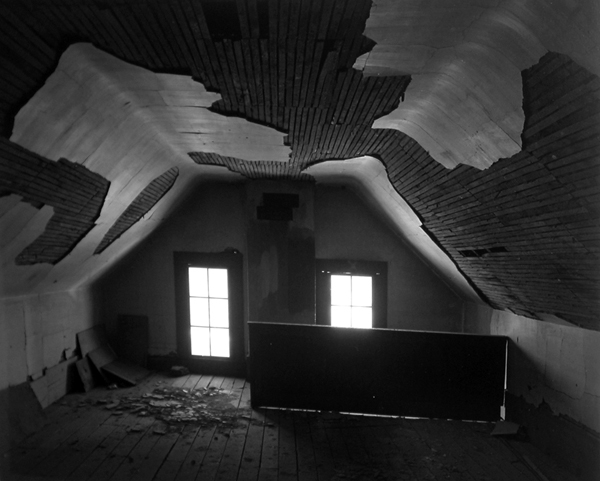 arched attic room plaster falling off wood low floor windows